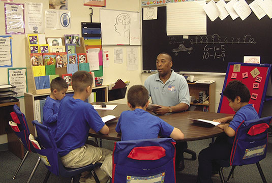 Command Sergeant Major Sherman Fuller, USA (Ret.), teaches a group of students at the Global Village Academy in Colorado Springs, Colorado, where he serves as principal