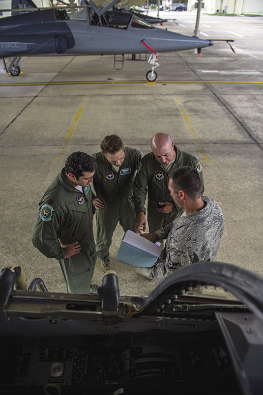 Technical Sergeant Eddie Martin provides maintenance status to pilots prior to their acceptance of the aircraft for flight operations
