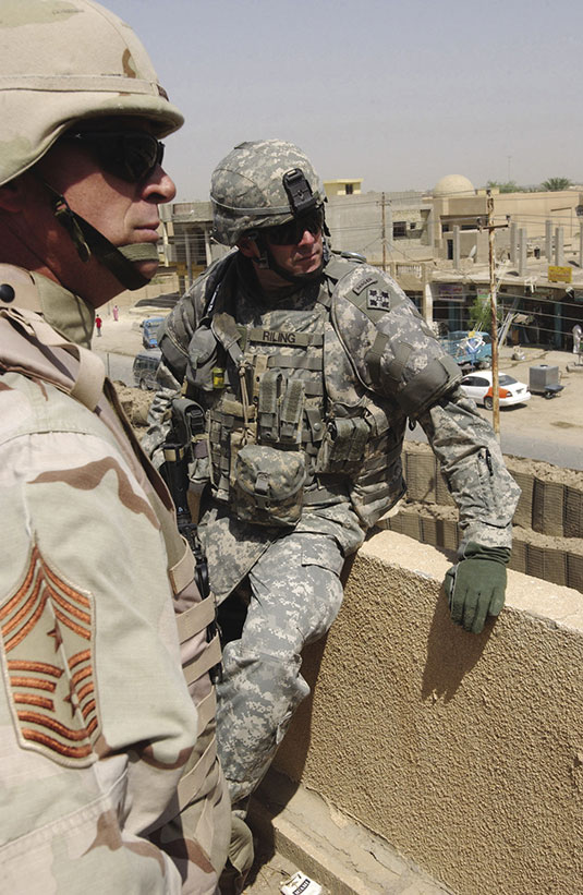 Chief Master Sergeant Curtis Brownhill (left), command sergeant major of U.S. Central Command, stands atop a patrol base in Tarmiya, Iraq, with Command Sergeant Ronald Riling, 4th Infantry Division, August 21, 2006. Brownhill visited troops throughout the Baghdad area bringing words of encouragement and an open ear to Soldiers' concerns