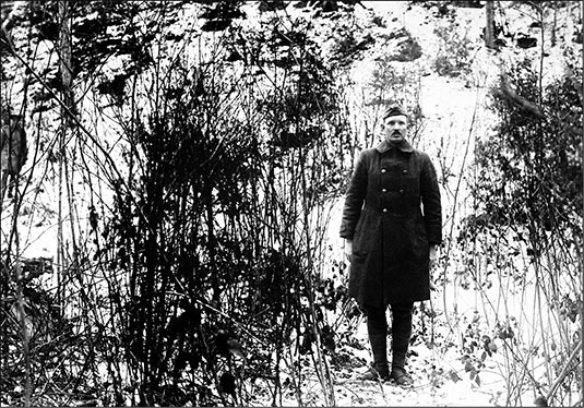 Sergeant Alvin C. York, 328th Infantry, who with the aid of 7 men captured 132 German prisoners, shows the hill on which the raid took place on October 8, 1918, in the Argonne Forest, near Cornay, France, after World War I (F.C. Phillips)