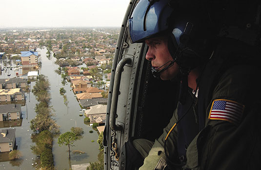 Coast Guard Petty Officer 2nd Class Shawn Beaty looks for survivors in the wake of Hurricane Katrina in New Orleans, Louisiana, August 30, 2005