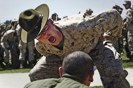 Staff Sergeant Antonio J. Curry, a drill instructor aboard Marine Corps Recruit Depot San Diego, barks out instructions to align his platoon of fresh recruits, August 30, 2012 (Kuande Hall)
