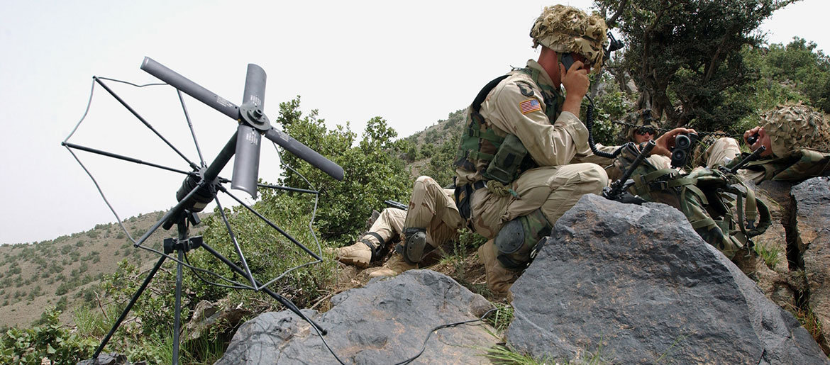 Soldier from 3/187th Infantry, 101st Airborne Division, out of Fort Campbell, Kentucky, sets up SATCOM to communicate further with key rear elements as part of search and attack mission in area of Narizah, Afghanistan, July 23, 2002 (U.S. Army/Todd M. Roy)