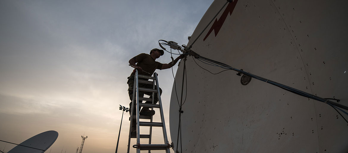 Airman with 379th Operations Support Squadron performs maintenance on satellite dish at Al Udeid Air Base, Qatar, March 30, 2018, as part of Operation Silent Sentry, protecting critical satellite communication links (U.S. Air National Guard/Phil Speck)