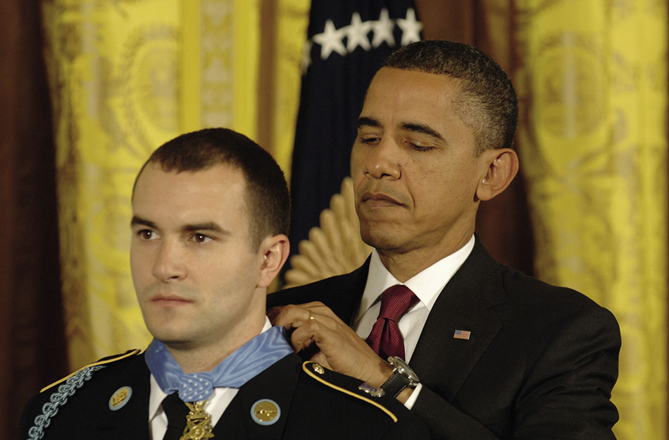 Staff Sergeant Salvatore Giunta, USA, first living recipient of Congressional Medal of Honor since Vietnam War, rescued two members of his squad during insurgent ambush in Afghanistan's Korengal Valley, October 2007 (U.S. Army/Leroy Council)