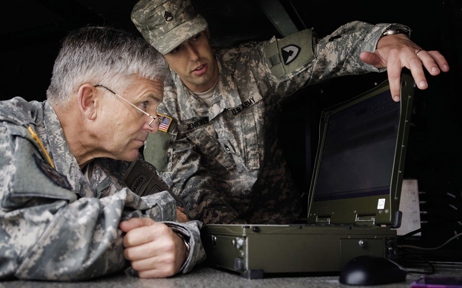 Army Staff Sergeant briefs Army Chief of Staff, General George W. Casey, Jr., about new technologies used in war against terrorism (U.S. Army/D. Myles Cullen)