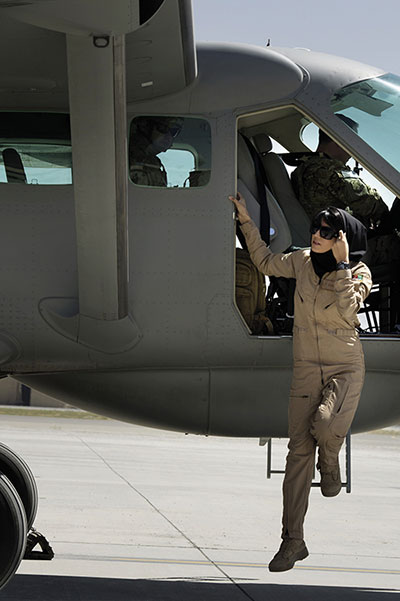 Afghan air force officer Niloofar Rhmani, accompanied by USAF 438th Air Expeditionary Advisory Group executive officer and AAF pilot advisor, deplanes Cessna 208 becoming first Afghan woman to fly fixed-wing combat mission (U.S. Air Force/Ben Bloker)