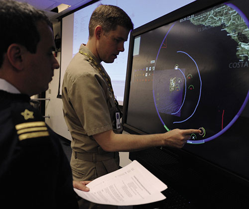 U.S. and Brazilian naval officers provide inputs to multitouch, multiuser interface during 2013 Inter-American War Game (U.S. Navy/James E. Foehl)