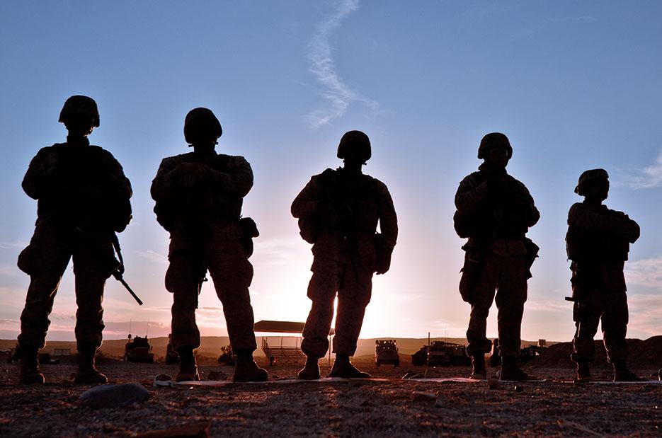 Combat Logistics Battalion 4 Marines stand by for sun to set before beginning night marksmanship shoot (U.S. Marine Corps/Mark Stroud)
