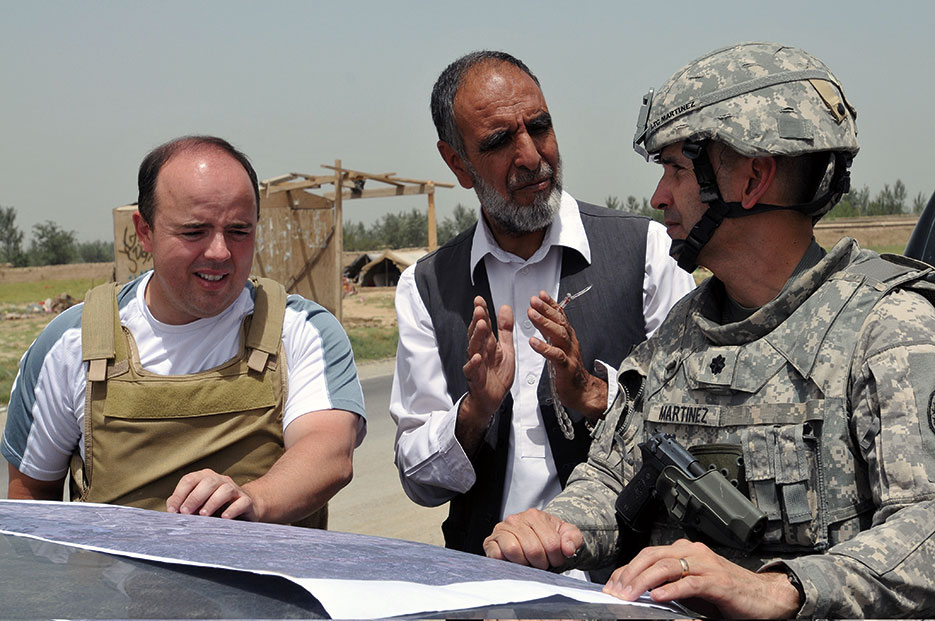 Chief engineer discusses power line construction with Kabul Electricity Directorate engineering liaison and U.S. State Department representative in Seh Du-kahn, Parwan Province (U.S. Navy/Tom Jones)