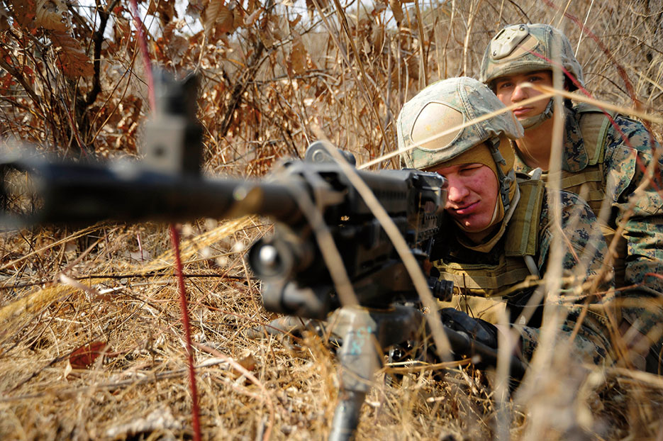 Marines select targets in tactical movement training at Camp Rodriguez, South Korea (DOD/James Norman)