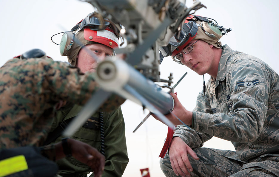 Airman helps Marine load missile at Kunsan Air Base, South Korea (U.S. Air Force/Armando A. Schwier-Morales)