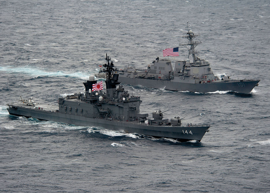 Japan Maritime Self-Defense Force destroyer JS Kurama under way with Arleigh Burke–class guided-missile destroyer USS <i>Gridley</span> during passing exercise (U.S. Navy/James R. Evans)