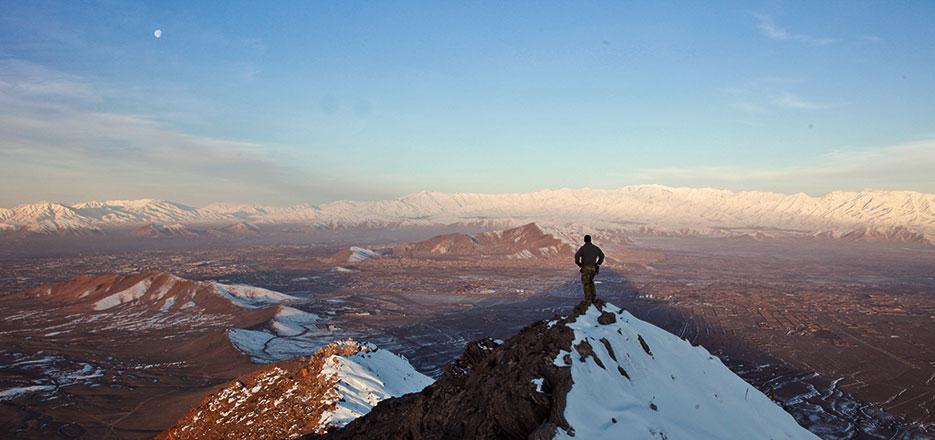 Member of coalition force surveys terrain in Kabul Province, Afghanistan (U.S. Army/Matthew Freire)