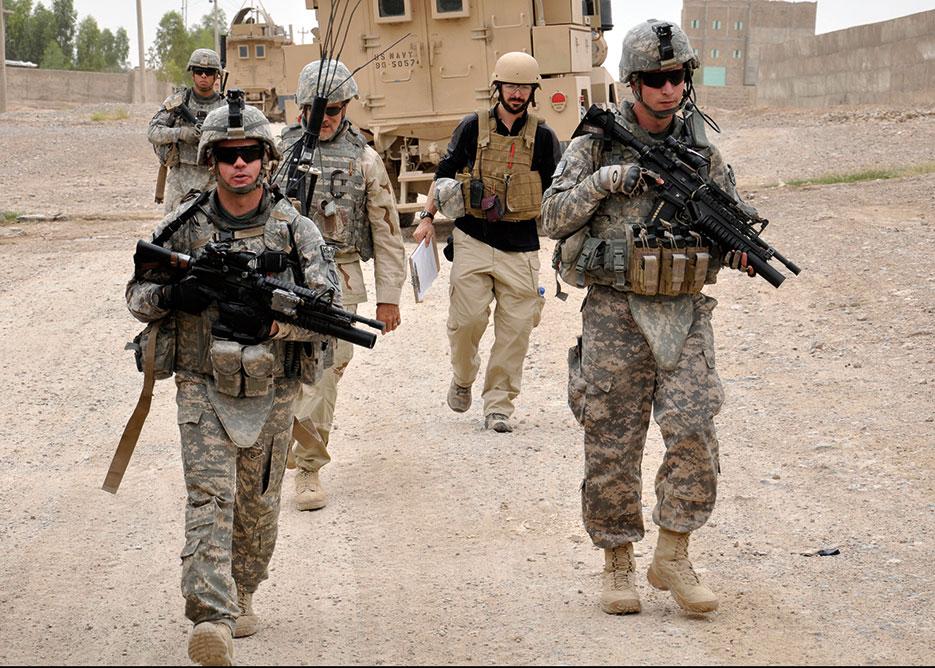 Kandahar PRT security force lead team member through Shur Andam Industrial Park in Kandahar City (U.S. Air Force /Richard Simonsen)