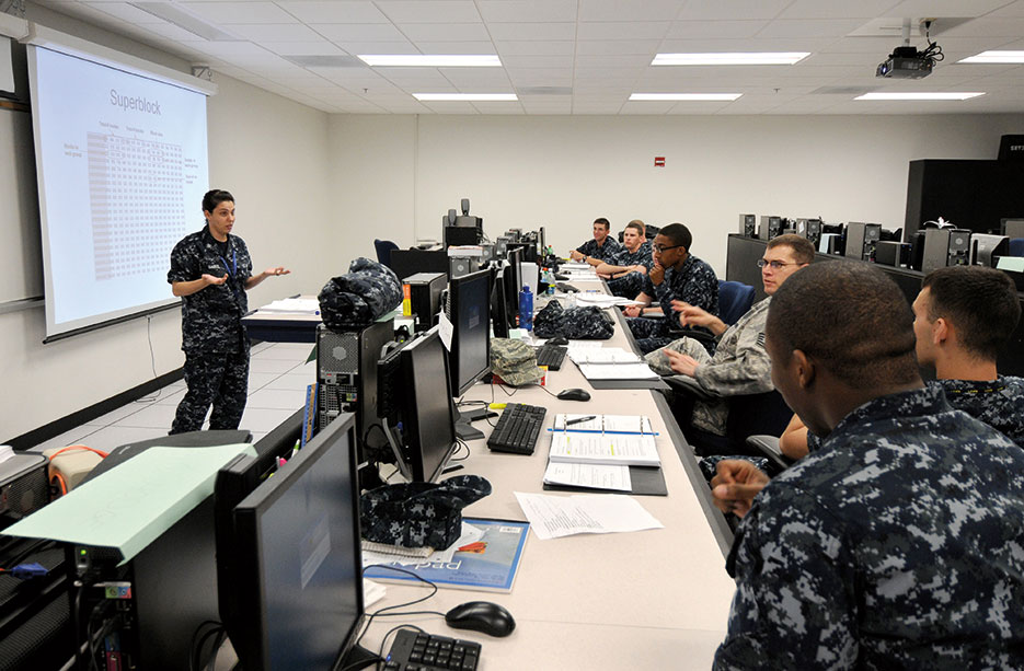 Students answer questions during Joint Cyber Analysis Course at Center for Information Dominance (U.S. Navy/Jessica Gaukel)