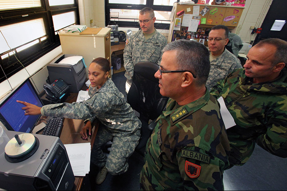 Army corporal explains Standard Army Retail Supply System to Albanian army officers at U.S. Property and Fiscal Office warehouse in Lawrenceville, New Jersey (U.S. Air Force/Mark Olsen)