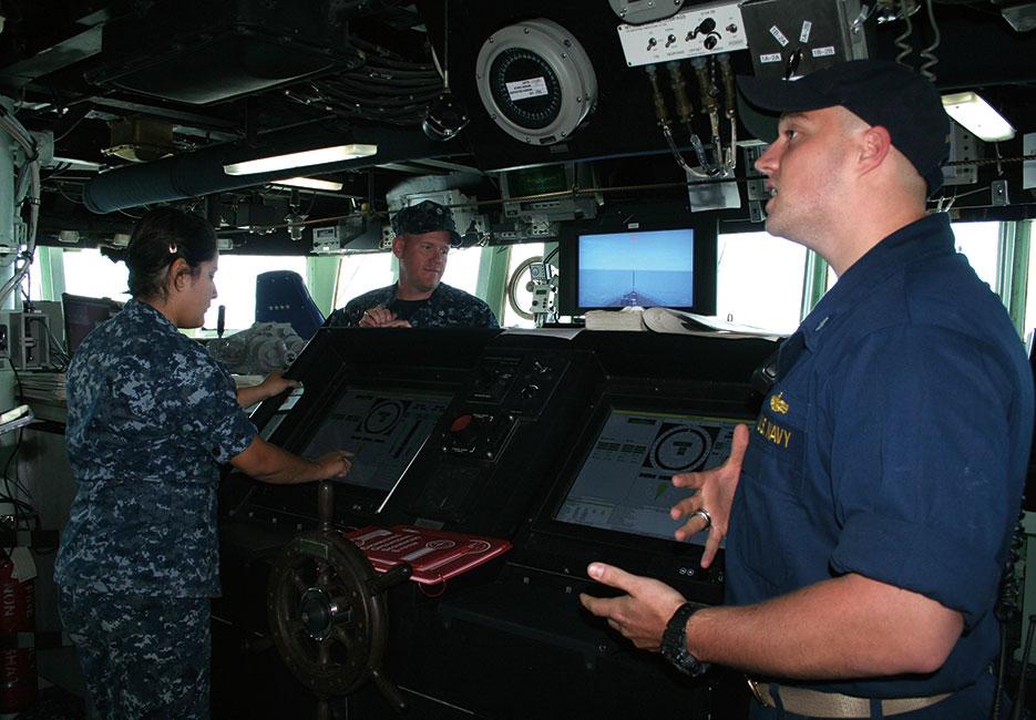 Navy lieutenant (junior grade) describes navigation system aboard USS Arleigh Burke (U.S. Navy/Shelby Wilfong)