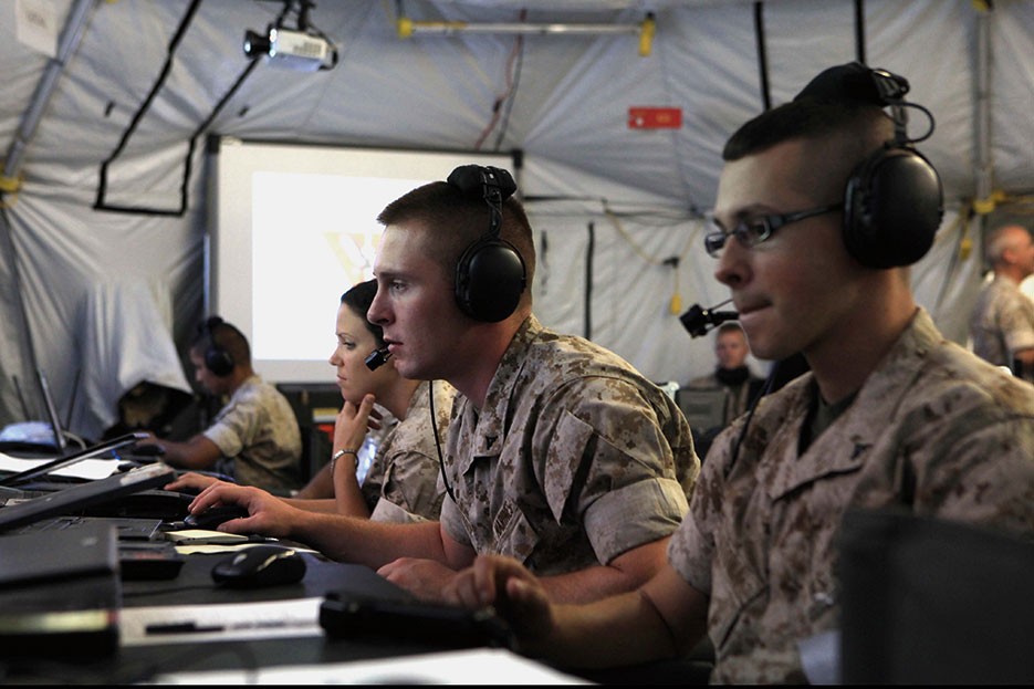 Marines monitor aircraft and ground troops for information to pass to combat elements, Operation Javelin Thrust (U. S. Marine Corps/ Chelsea Flowers)