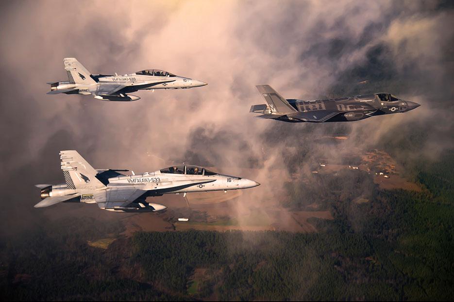 Marine F/A-18 Hornets escort F-35 Lightning II to Eglin Air Force Base, Florida (U.S. Air Force/Joely Santiago)