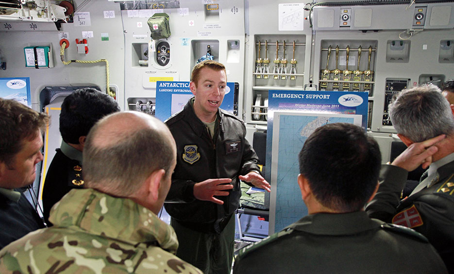62nd Operations Group executive officer briefs international fellows from U.S. Army War College on scientific research mission in Antarctica supported by Airmen from Joint Base Lewis-McChord (U.S. Army/Jennifer Spradlin)