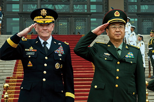 Chairman and PLA Chief of General Staff salute as Chinese troops pass in review in Beijing (DOD/D. Myles Cullen)