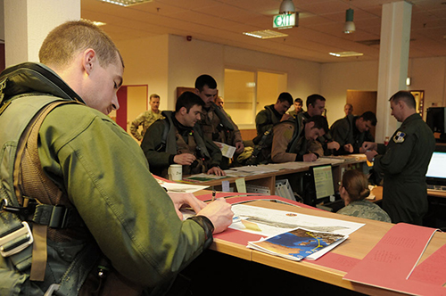 Pilots briefed in support of Operation Odyssey Dawn (U.S. Air Force/Benjamin Wilson)