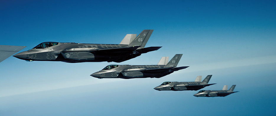 U.S. Air Force F-35A Lightning II Joint Strike Fighters fly in formation off right wing of KC-135R Stratotanker following aerial refueling mission along Florida coast (U.S. Air Force/John R. Nimmo, Sr.)