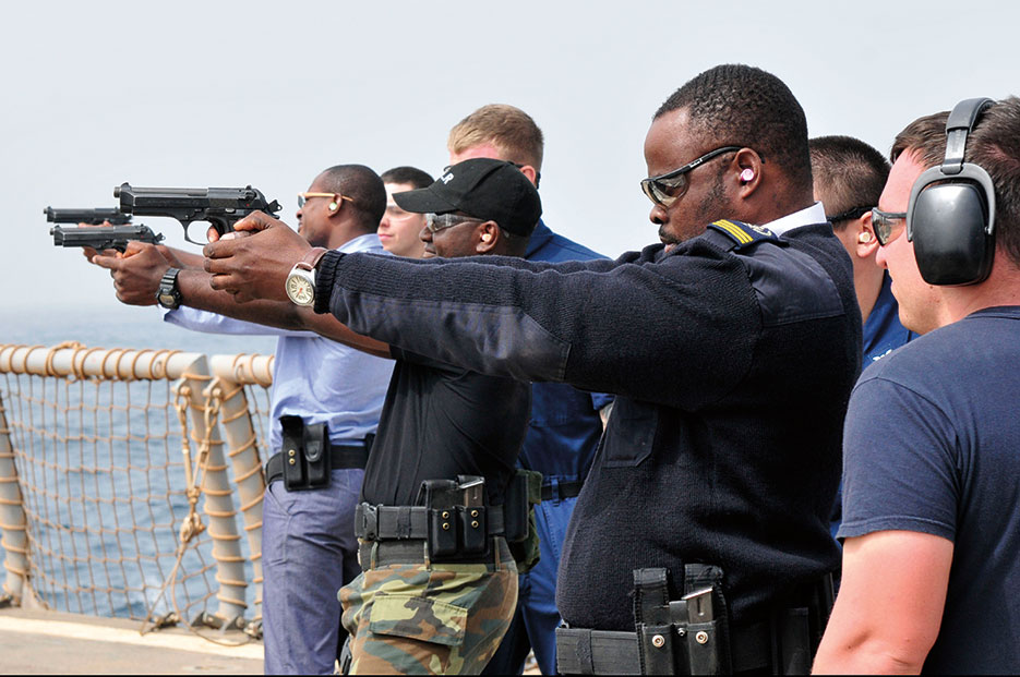 Cameroon, Gabon, and Republic of Congo sailors receive small-arms qualifications training aboard USS Simpson as part of Africa Partnership (U.S. Navy/Felicito Rustique)