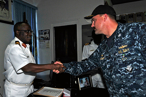 Commanding officer of USS Simpson greets Nigerian navy commander of Headquarters Naval Training Command during Africa Partnership (U.S. Navy/Felicito Rustique)