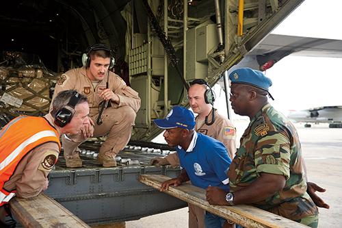 U.S. and Angolan airmen discuss unloading C-130J Super Hercules as part of African Partnership Flight with Angolan and Zambian air forces (U.S. Air Force/Benjamin Wilson)