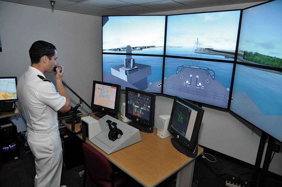 Sailor assigned to amphibious transport dock ship USS Ponce uses voice-recognition system to command virtual simulation of Ponce in Conning Officer Virtual Environment (U.S. Navy/Nathanael Miller)