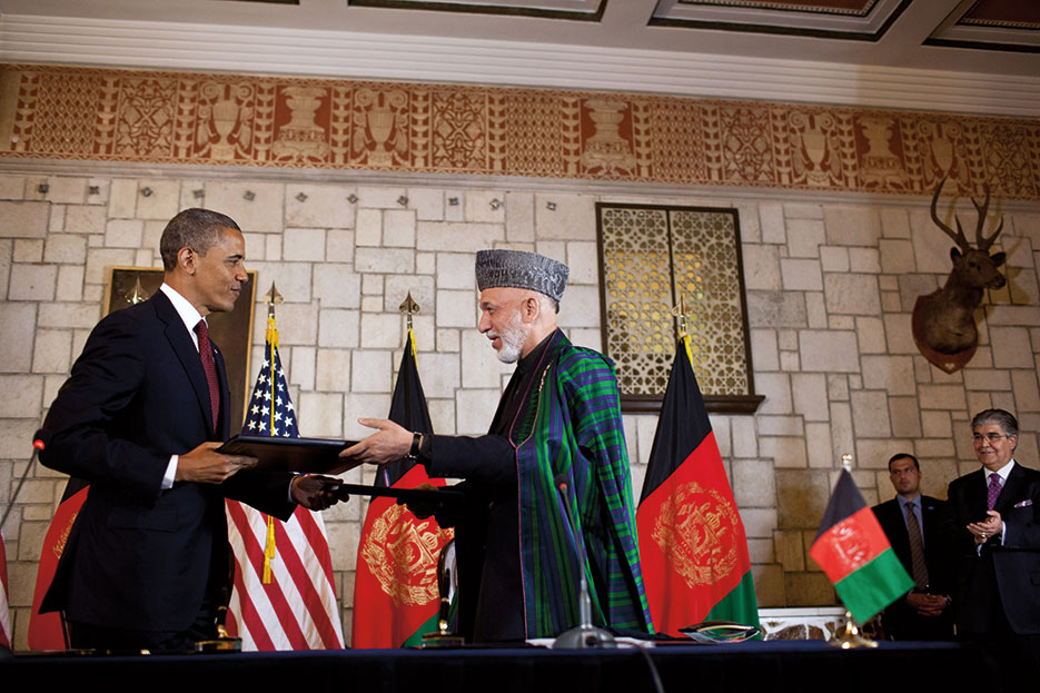 President Obama and Afghan President Hamid Karzai exchange documents at Presidential Palace in Kabul after signing Enduring Strategic Partnership Agreement (White House/Pete Souza)