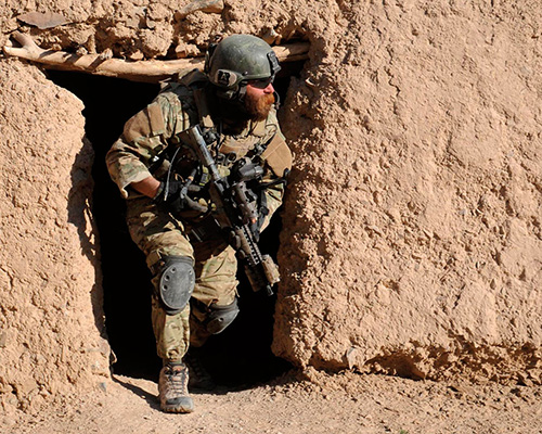 Special Forces Soldier exits building during operations in Arghandab District, Afghanistan (U.S. Army/Gino Palu)