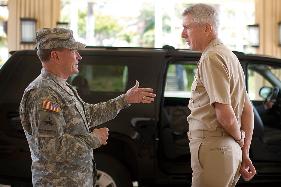 Chairman and Admiral Samuel J. Locklear, USN, commander, U.S. Pacific Command, talk before departing Camp Smith, Hawaii (DOD/D. Myles Cullen)