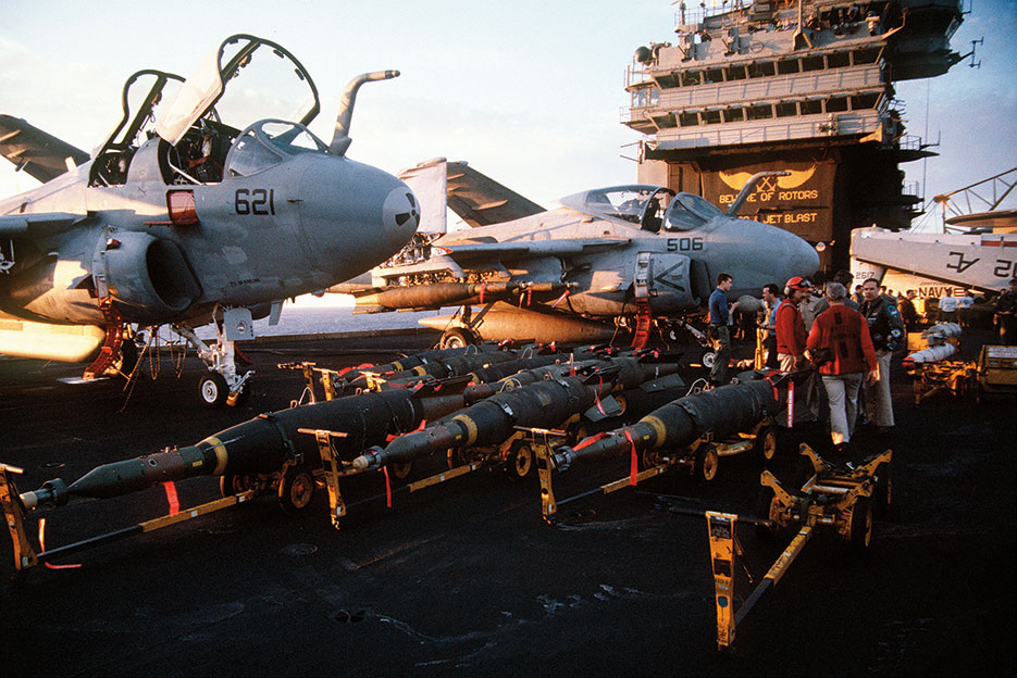 Laser-guided bombs line flight deck of aircraft carrier USS John F. Kennedy in preparation for air strikes against Iraq during Operation Desert Storm (PH2 Lipski)