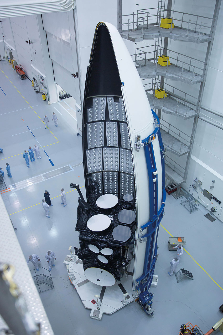 Workers prepare for launch of third Advanced Extremely High Frequency satellite, a joint-Service system that provides survivable, near worldwide, secure, protected, and jam-resistant communications for high-priority national military operations (Courtesy Lockheed Martin)