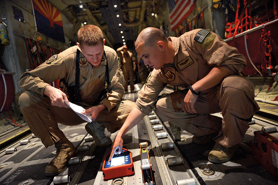 Senior Airmen program Wireless Gate Release System before airdrop at Bagram Air Field (U.S. Air Force/Evelyn Chavez)