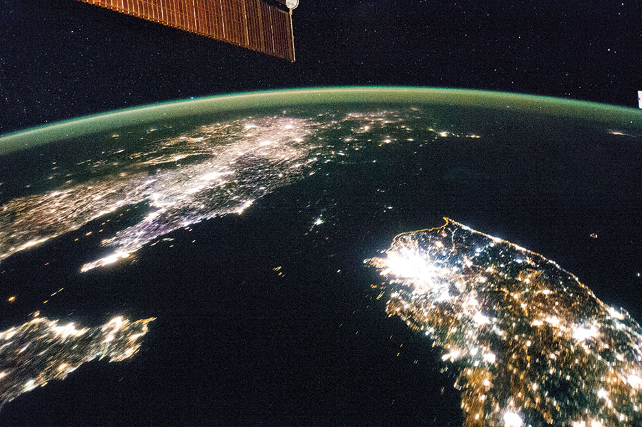 Flying over East Asia, Expedition 38 crewmember on International Space Station took this night image of the Korean Peninsula (NASA)