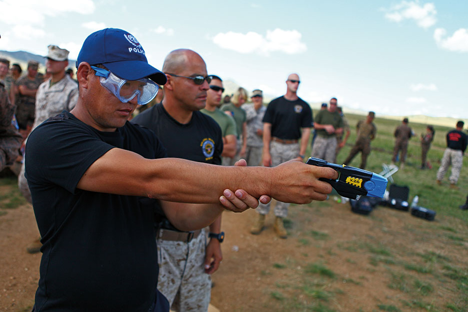 Mongolian police officer operates X26 taser during nonlethal weapons training at Five Hills Training Area, Mongolia, August 2013 (U.S. Marine Corps/Ben Eberle)