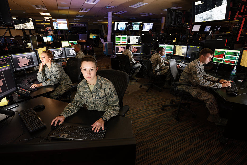 Airmen working on Distributed Ground Station–1 Operations Floor at the U.S. Air Force's 480th Intelligence, Surveillance, and Reconnaissance Wing (U.S. Air Force)