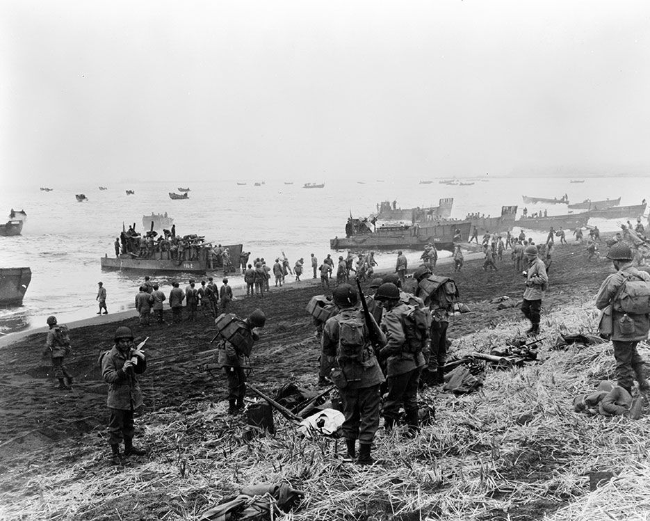 Landing boats pouring southern landing force Soldiers and their equipment onto beach at Massacre Bay, Attu, Aleutian Islands (Library of Congress, Prints & Photographs Division, FSA/OWI Collection)
