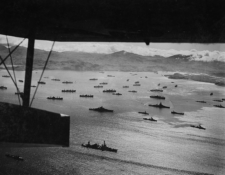 Part of huge U.S. fleet at anchor in Adak Harbor in Aleutians, ready to move against Kiska (NARA/U.S. Army Air Forces/Horace Bristol)