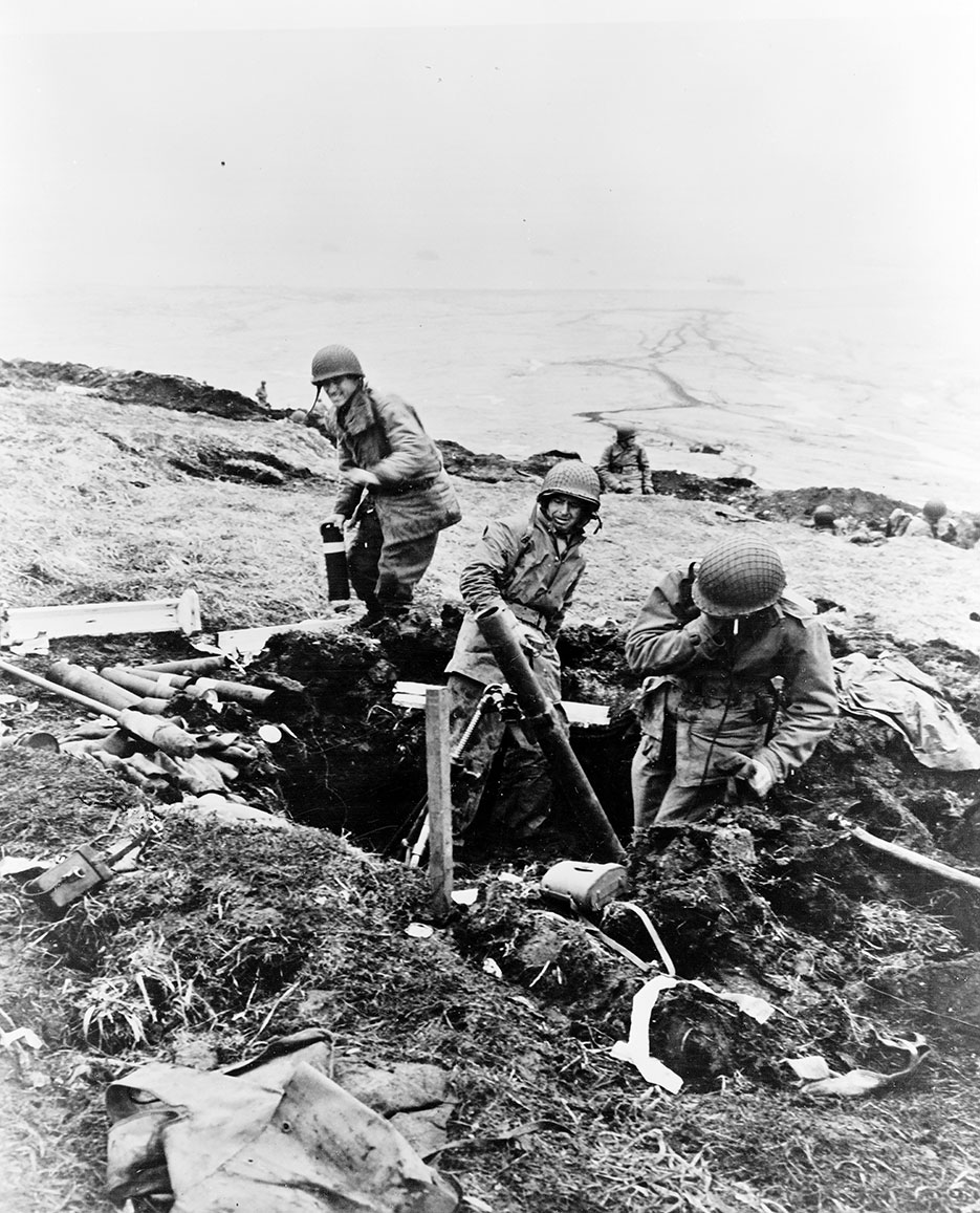 Soldiers hurling trench mortar shells over ridge into Japanese positions, Attu, Aleutian Islands (Library of Congress, Prints & Photographs Division, FSA/OWI Collection)