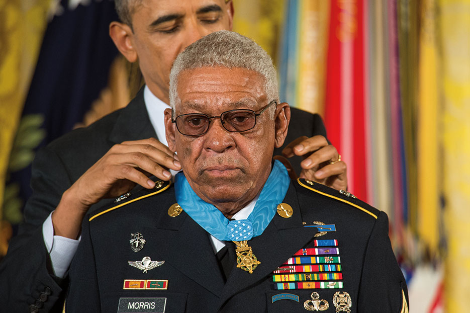 U.S. Army Sergeant 1st Class Melvin Morris receives Medal of Honor from President Obama inside White House, March 2014 (U.S. Army/Mikki L. Sprenkle