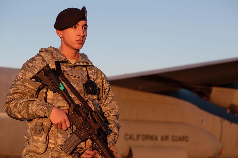 Airman walks perimeter of C-130J Hercules, November 2014 (U.S. Air National Guard/Matt Hecht)