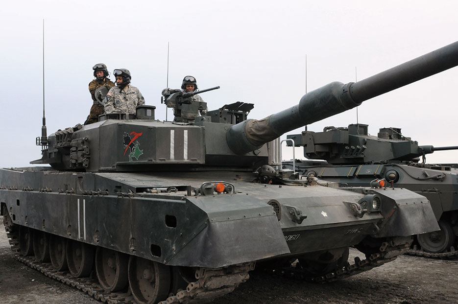I Corps senior enlisted leader and U.S. Army–Japan senior enlisted leader test-drive Japanese Type 90 tank at Camp Higashi-Chitose, Japan, on study tour during Yama Sakura 65 (U.S. Army/Chalon Hutson)