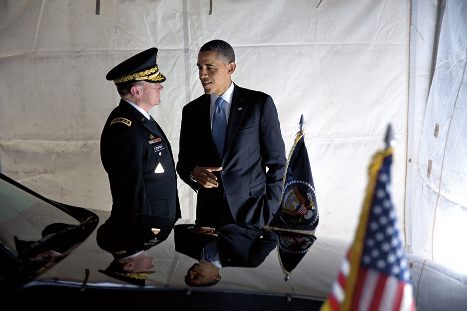 President Obama talks with General Dempsey after attending Armed Forces farewell tribute for Secretary Leon Panetta at Joint Base Myer–Henderson Hall (White House/Pete Souza)