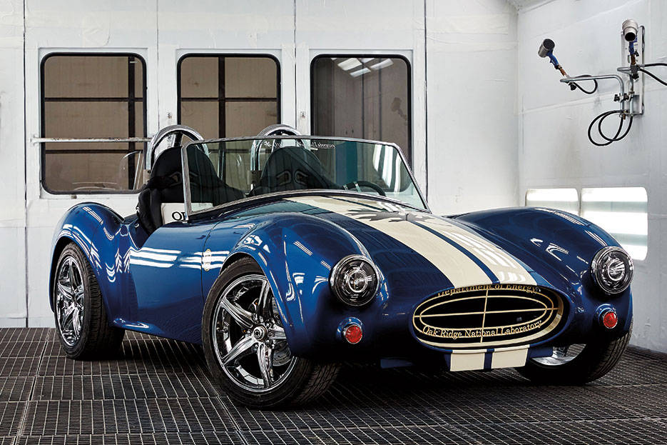 Shelby Cobra—approximately 1,400-pound vehicle containing 500 pounds of printed parts made of 20 percent carbon fiber—produced by Big Area Additive Manufacturing Machine, which manufactures strong, lightweight composite parts in sizes greater than 1 cubic meter (DOE)