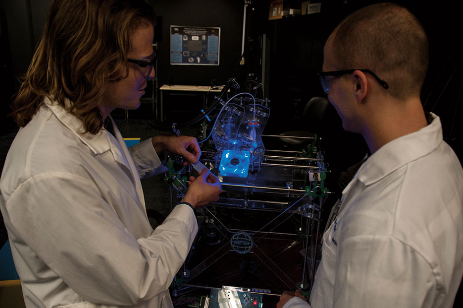Research engineers use 3-D printer in their work at FDA (FDA/Michael J. Ermarth)